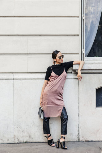 dress tumblr pink dress pink satin slip dress slit dress slip dress dress over t-shirt t-shirt black t-shirt dress over pants leather pants black leather pants sandals sandal heels high heel sandals sunglasses satin dress satin silk slip dress