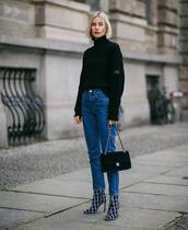 bag,flap bag,chanel bag,jeans,black sweater,jimmy choo shoes,ankle boots,heel boots