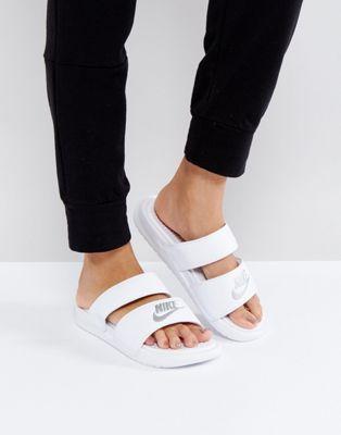 Nike Benassi Duo Logo Slider Sandals In White at asos.com