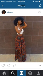 skirt,maxi skirt,maxi floral skirt,tribal pattern,floral,african print,cute,long,long skirt,flowered skirt,top,shoes,white top,half shirt,shirt,pants,pattern,entire outfit,brown skirt with blue floral designs,dress