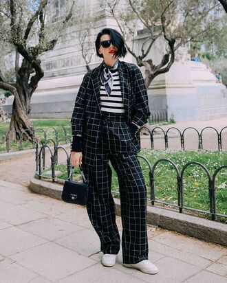 bag stripes shoes pants blazer top black and white sunglasses neck scarf