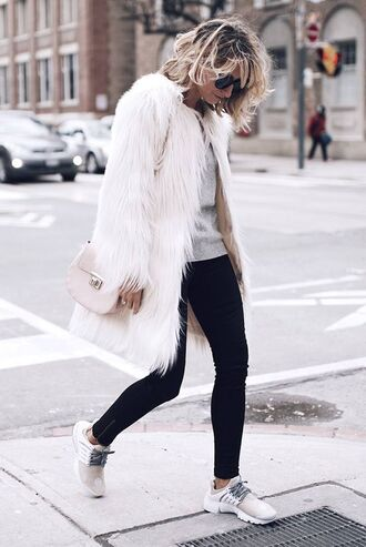 coat white fur coat white coat fur coat jeans black jeans sweater grey sweater sneakers white sneakers adidas adidas shoes sporty chic bag white bag sunglasses streetstyle winter outfits winter look leggings