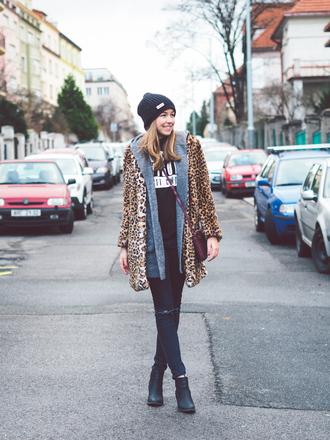 a cup of style blogger sweater winter outfits leopard print faux fur jacket knitted beanie fur leopard print winter coat beanie black beanie fur coat bag crossbody bag denim jeans blue jeans ripped jeans boots ankle boots black boots