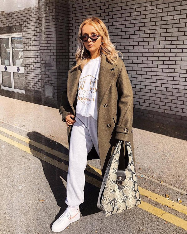 coat double breasted wool coat oversized sweater joggers white sneakers handbag snake print cat eye