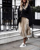 sweater,black sweater,skirt,gold skirt,sneakers,white sneakers,handbag,black handbag,shoes,bag