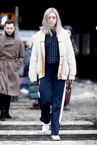 cardigan tumblr nyfw 2017 fashion week 2017 fashion week streetstyle white cardigan pants blue pants side stripe pants sweater blue sweater navy sneakers white sneakers bag brown bag winter outfits winter look