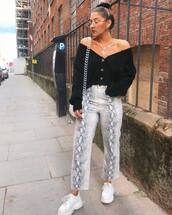 pants,snake print pants,white sneakers,platform sneakers,off the shoulder sweater,oversized sweater,round sunglasses,shoulder bag,chain bag,earrings