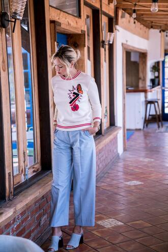 late afternoon blogger sweater pants shoes sunglasses jewels blue pants mules spring outfits