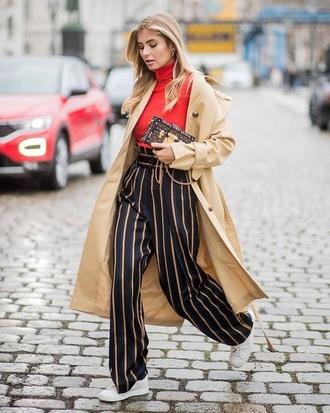 pants striped pants top red top coat trench coat camel coat sneakers white sneakers wide-leg pants