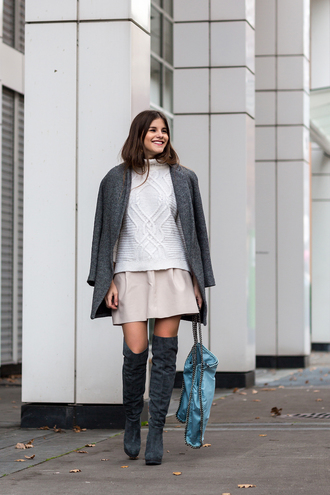 the fashion fraction blogger skirt bag cable knit winter coat grey coat winter outfits thigh high boots coat sweater shoes jewels white cable knit sweater mini skirt over the knee boots grey boots blue bag chain bag turtleneck turtleneck sweater