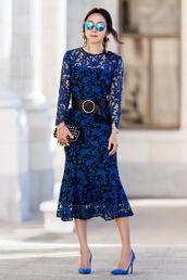 fit fab fun mom,blogger,blue dress,clutch,high heel pumps,blue heels,lace dress,long sleeve dress,belted dress,midi dress,mirrored sunglasses,blue sunglasses