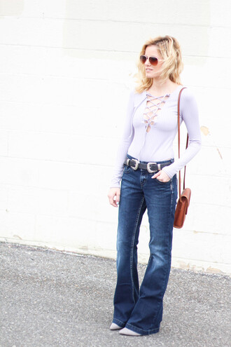 kim tuttle the knotted chain - a style blog by kim tuttle blogger jeans shoes belt sunglasses bag lace up bodysuit double buckle belt flare jeans blue jeans lace up top blue top baby blue long sleeves brown bag shoulder bag aviator sunglasses fall outfits long sleeve bodysuit