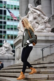 the vogue word,blogger,army green jacket,timberlands,winter swag,black skinny jeans