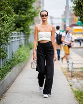 pants,wide-leg pants,high waisted pants,sneakers,crop tops,handbag,retro sunglasses