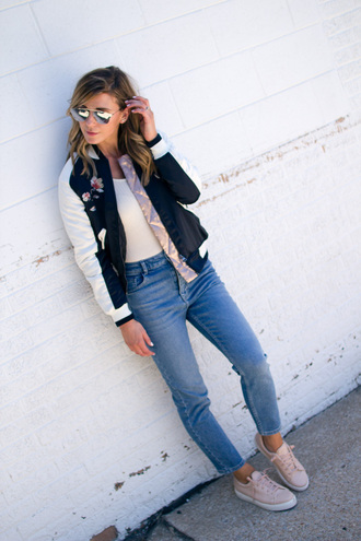 cella jane blogger jeans shoes bomber jacket skinny jeans aviator sunglasses white top sneakers pink sneakers satin bomber black bomber jacket black and white top silver sunglasses mirrored sunglasses blue jeans casual spring outfits