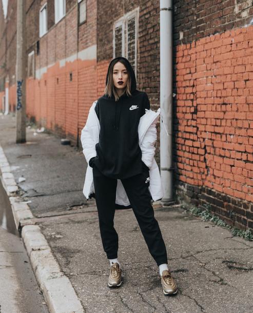 top hoodie pants sweatpants black pants sneakers gold sneakers jacket coat white coat casual