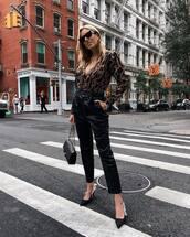 pants,leather pants,high waisted pants,gold chain pumps,long sleeves,printed blouse,handbag,mid heel pumps,sunglasses