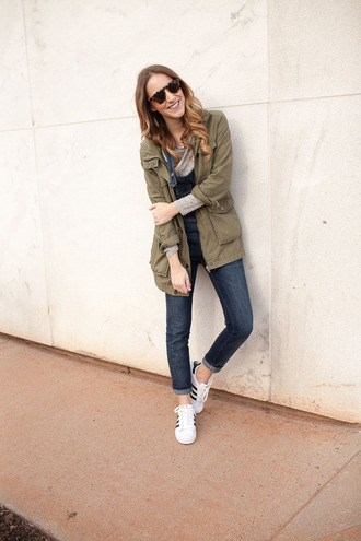 twenties girl style blogger t-shirt jacket shoes sunglasses sneakers overalls army green jacket