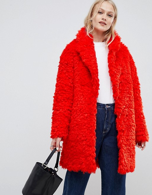 ASOS DESIGN coat in fluffy borg at asos.com