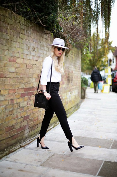 pants stirrup pants black pants shirt white shirt hat white hat felt hat pumps pointed toe pumps high heel pumps shoes black shoes heels black heels bag black bag thick heel block heels sunglasses top