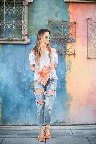 shoes pom pom sandals pom poms sandals flat sandals denim jeans blue jeans ripped jeans top white top white lace top lace top off the shoulder top clutch striped clutch sunglasses blue sunglasses summer outfits summer top