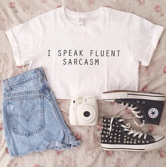 white top quote on it converse black sneakers studded studs denim shorts shorts outfit polaroid camera white t-shirt