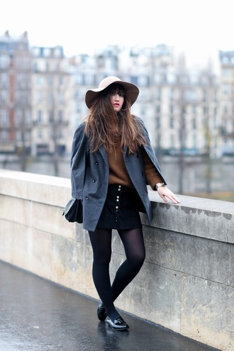 meet me in paree blogger winter outfits button up skirt floppy hat loafers black loafers grey coat sweater camel mini skirt black skirt tights