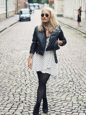 the little magpie,blogger,jacket,dress,leather jacket,polka dots,black and white,mini dress,ankle boots,black boots,round sunglasses,short dress,black leather jacket,black jacket,sunglasses,suede boots,high heels boots,tights,zalando,opaque tights