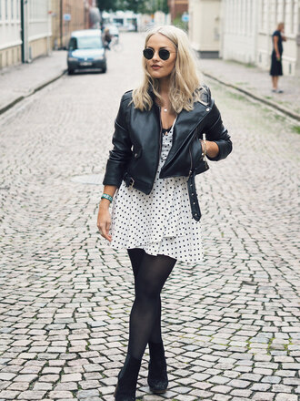the little magpie blogger jacket dress leather jacket polka dots black and white mini dress ankle boots black boots round sunglasses short dress black leather jacket black jacket sunglasses suede boots high heels boots tights zalando