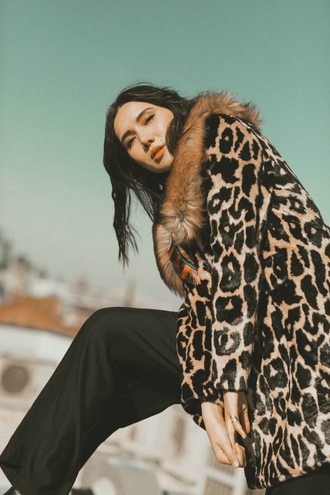 dylana suarez blogger coat scarf pants winter outfits animal print animal print coat