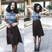 alessandra kamaile,blogger,top,muscle tee,quote on it,graphic tee,plaid skirt,holes,red lipstick,grunge,skirt,shirt,tights,red,black