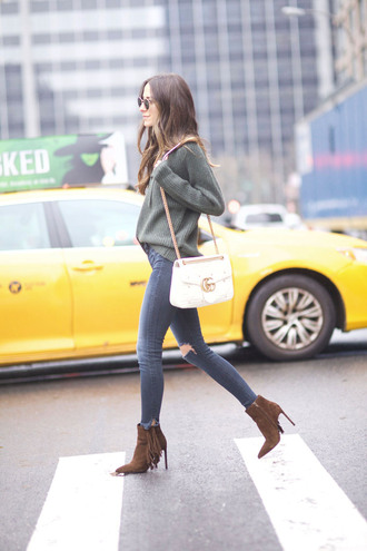 something navy blogger jeans shoes sunglasses sweater bag gucci bag gucci ankle boots skinny jeans grey sweater fall outfits tumblr green sweater denim blue jeans ripped jeans boots fringes fringe shoes brown boots high heels boots chain bag