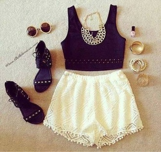 white shorts gold sunglasses black shoes black crop top bracelets chain necklace