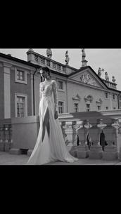 dress,lace dress,long prom dress,lace,low cut dress,long sleeve dress,leg slit