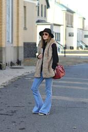 to be bright,blogger,jeans,hat,faux fur vest,flare pants,red bag,kick flare,beige fur vest,felt hat,bag,denim,blue jeans,flare jeans