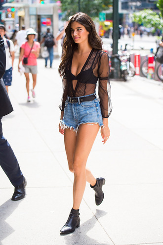 blouse top see through black top shorts denim shorts model off-duty streetstyle ankle boots sara sampaio plunge v neck