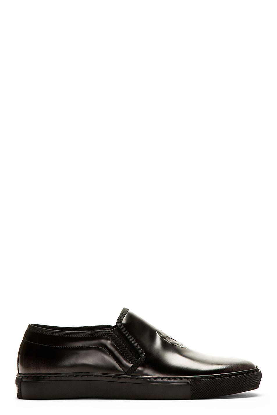 alexander mcqueen black embossed skull slip_on shoes
