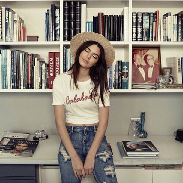 kendall jenner jeans ripped jeans distressed denim shirt calabasas crop tops wide brim fedora straw fedora graphic tee hat