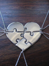jewels,heart,puzzle,one direction,necklace,bag,where to get this necklace,silver jewelry,names,heart jewelry,friendship necklace,help plz
