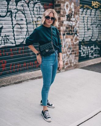 sweater tumblr green sweater denim jeans blue jeans skinny jeans sneakers black sneakers low top sneakers sunglasses bag crossbody bag