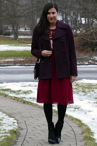 closetfashionista blogger dress tights shoes bag jewels coat red dress ankle boots winter outfits