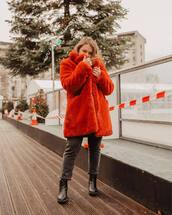 coat,faux fur coat,grey jeans,ankle boots,black boots,orange coat,winter outfits,winter coat