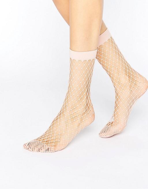 ASOS Oversized Fishnet Ankle Socks at asos.com