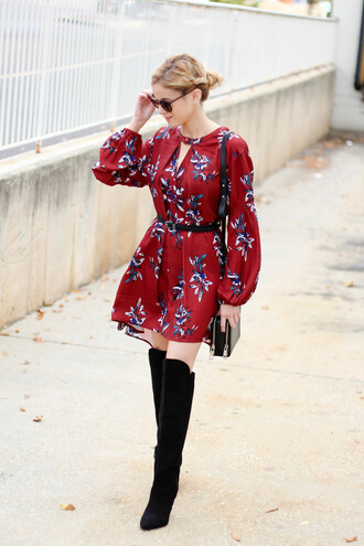 kim tuttle blogger red dress floral dress knee high boots black boots fall dress belted dress red mini dress puffed sleeves mini dress short dress long sleeve dress long sleeves sunglasses over the knee boots over the knee black bag bag shoulder bag belt black belt high heels boots fall outfits puff sleeve dress