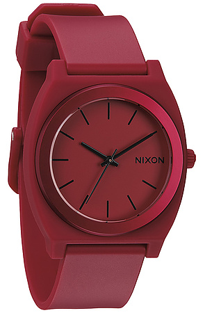 The watch nixon time teller p  in dark red ano