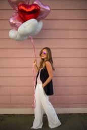 gal meets glam,blogger,wide-leg pants,white pants,vest,heart sunglasses,valentines day