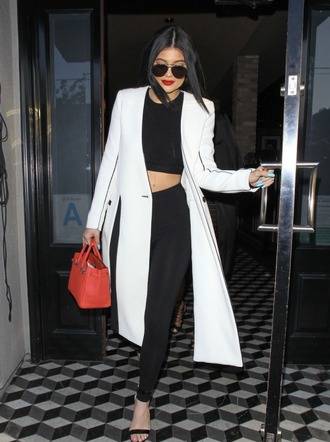 coat black and white kylie jenner leggings sandals crop tops sunglasses top