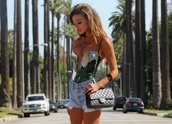 tank top,top,deep v,sexy shirt,hot,floral top,shirt,strapless,corset top,white,green,palm tree print,badingsuit,summer,summer outfits,shorts,tanned girl,black bag,blonde hair,blouse,floral,fashion,clothes,girly outfits tumblr,tumblr,crop tops,High waisted shorts,sexy,green top,slit,bustier,blue,corset,bodysuit,t-shirt,cut-out,swimwear,palm print swimming dress,deep v cut,summer top,chanel,chanel purse,crossbody bag,one piece swimsuit,one piece,one piece bathing suit,palm tree,tropical swimwear