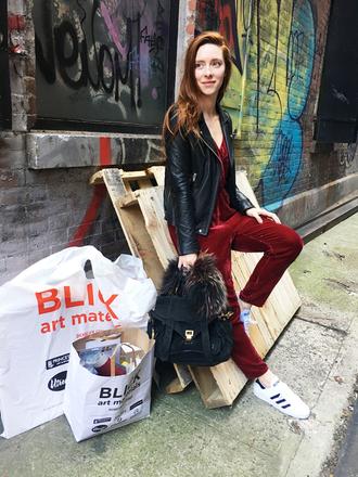 man repeller blogger jumpsuit jacket scarf bag black leather jacket black bag red jumpsuits sneakers