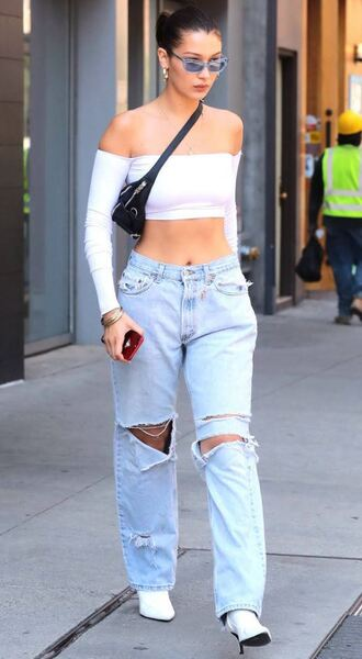 top off the shoulder off the shoulder top white white top ripped jeans denim bella hadid model off-duty streetstyle